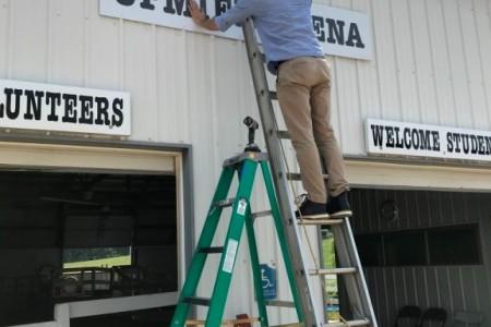 putting-up-Sign.jpeg